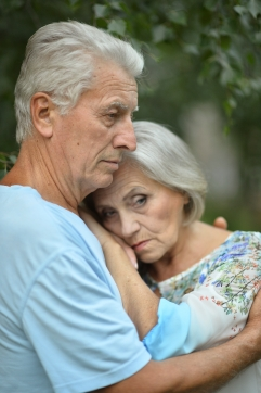 Sad senior couple in  park