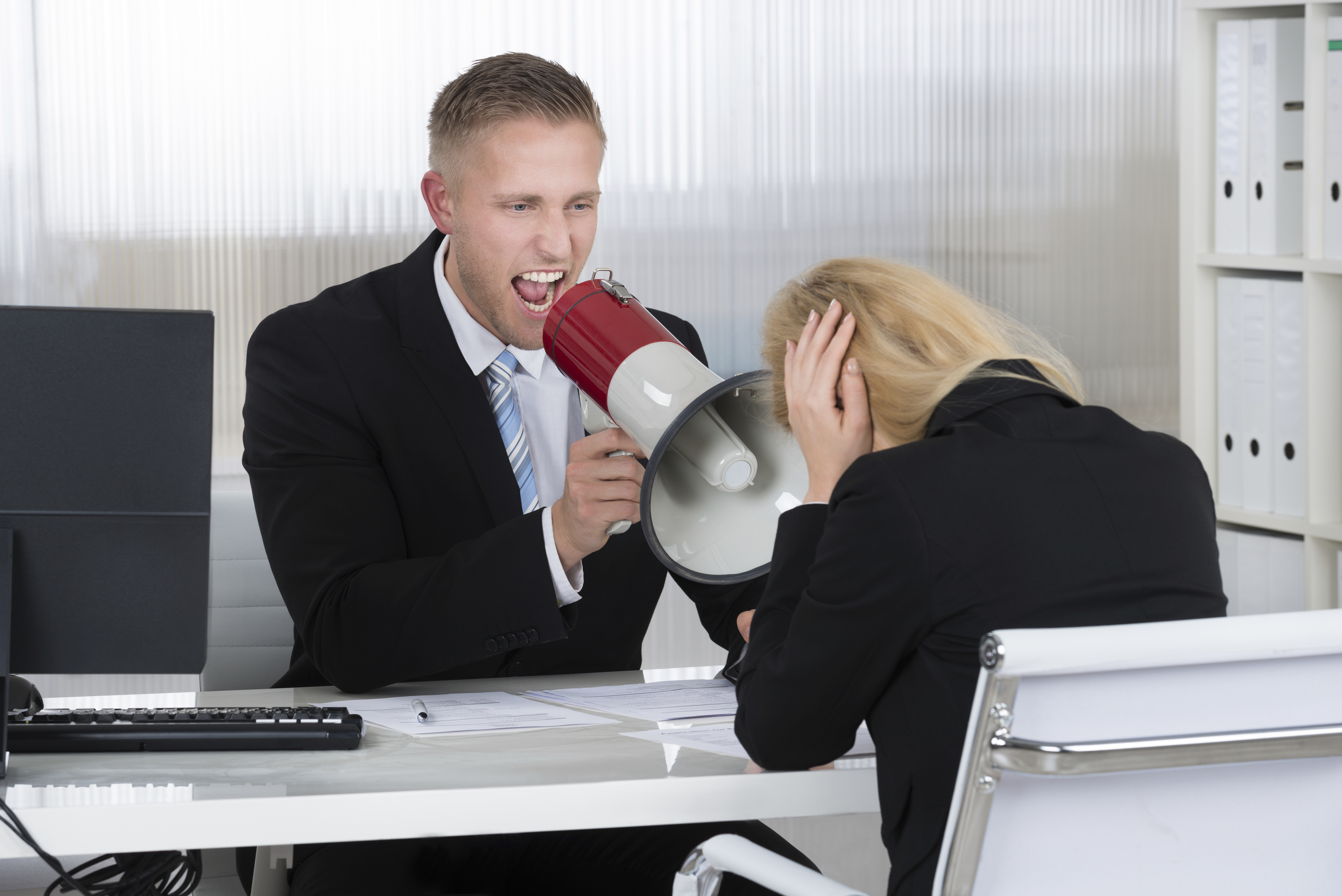 Boss Shouting At Businesswoman Through Loudspeaker In Office